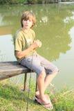 Boy fishing on pond Royalty Free Stock Photos