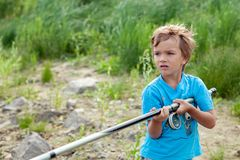 Boy fishing on river, summer Royalty Free Stock Image