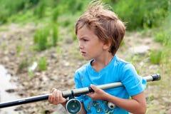 Boy fishing on river, summer Stock Photos
