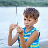 Boy fishing on river, summer Stock Images