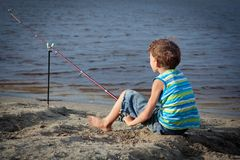 Boy fishing on river, summer Royalty Free Stock Photography