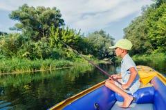 Boy fishing at the river Royalty Free Stock Photo