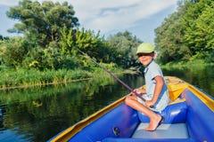 Boy fishing at the river Stock Photo