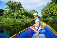 Boy fishing at the river Stock Photos