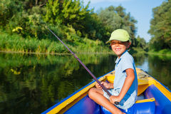 Boy fishing at the river Royalty Free Stock Photography