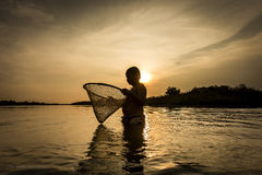 Boy fishing on the river. Stock Image
