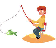 Boy fishing with a rod sitting on river, pond bank Royalty Free Stock Image