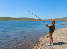 Boy fishing on spinning Royalty Free Stock Image