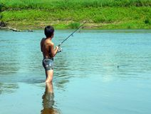 Boy fishing with spinning Stock Images