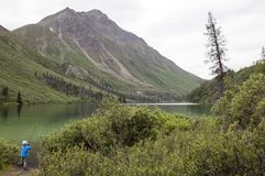 Boy Fishing in St. Elias Lake, Yukon, Canada Stock Photo