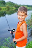 Boy fishing Stock Photo