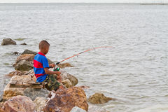 Boy fishing at thai sea Royalty Free Stock Photo