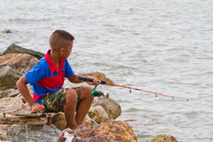 Boy fishing at thai sea Stock Image