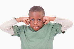 Boy with the fists on his face Stock Photo