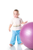 Boy with the fitness ball Royalty Free Stock Photos