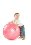 Boy with a fitness ball. A little boy with a big pink fitness ball Royalty Free Stock Image