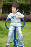 Boy and Fitness Equipment. Chinese boy and Fitness Equipment Royalty Free Stock Images