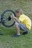 Boy fixing bike gears Royalty Free Stock Photos