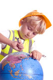 Boy fixing our world. Young boy trying to fixing the world that we have left behind Royalty Free Stock Image