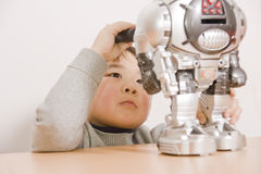 Boy fixing robot Royalty Free Stock Photography