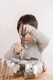 Boy fixing robot Royalty Free Stock Photo