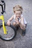 Boy Fixing Wheel Of Bike. Childhood.Cycling Royalty Free Stock Photo