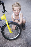 Boy Fixing Wheel Of Bike. Childhood.Cycling Royalty Free Stock Image