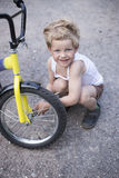 Boy Fixing Wheel Of Bike. Childhood.Cycling Royalty Free Stock Images