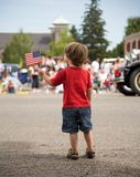 Boy with a flag. Young boy at a parade with an American Flag Stock Photos
