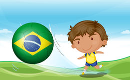 A boy beside the flag of Brazil Royalty Free Stock Photo