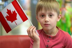 Boy with the flag of Canada Stock Image