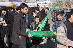 Boy with a flag during Iranian religious holiday arbaeen Stock Images