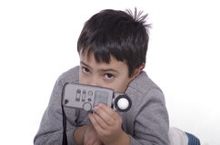 Boy and flash meter Stock Photo