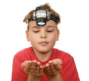 Boy with flashlight on his head on white Royalty Free Stock Photos