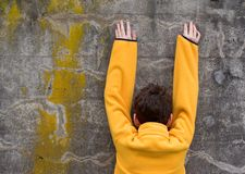 Boy in   Fleece Pullover. Photo of Boy in  and Fleece Pullover against concrete wall Royalty Free Stock Photo