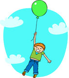 The boy flies on a ballon. The boy with red hair in green T-shirt and blue pants flies in the sky on a green ballon Royalty Free Stock Photo
