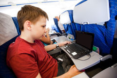 Boy flies in the plane Royalty Free Stock Images