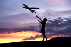 Boy flies a toy plane. Royalty Free Stock Images