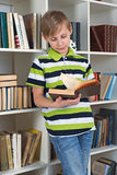 Boy flipping book Royalty Free Stock Photos