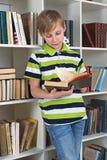 Boy flipping book Royalty Free Stock Photos