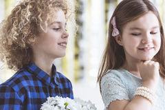 Boy flirting with girl Royalty Free Stock Images