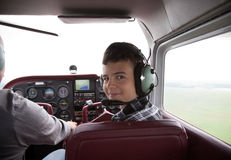 Boy fliyng in the plane cabin. Sky flight Royalty Free Stock Images