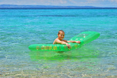 Boy with float Royalty Free Stock Images
