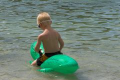 Boy & float Stock Photos