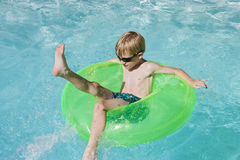 Boy On Float Tube In Swimming Pool Royalty Free Stock Photo
