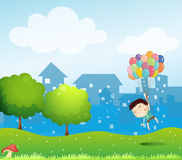 A boy floating in the air with the balloons Royalty Free Stock Images