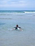 Boy Floating away at sea Stock Photos