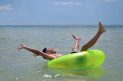Boy floating in green ring Royalty Free Stock Images