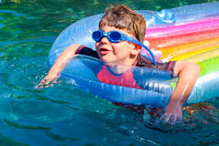 Boy floating on lilo Royalty Free Stock Images