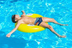 Boy Floating On An Inflatable Circle In The Pool. Stock Images